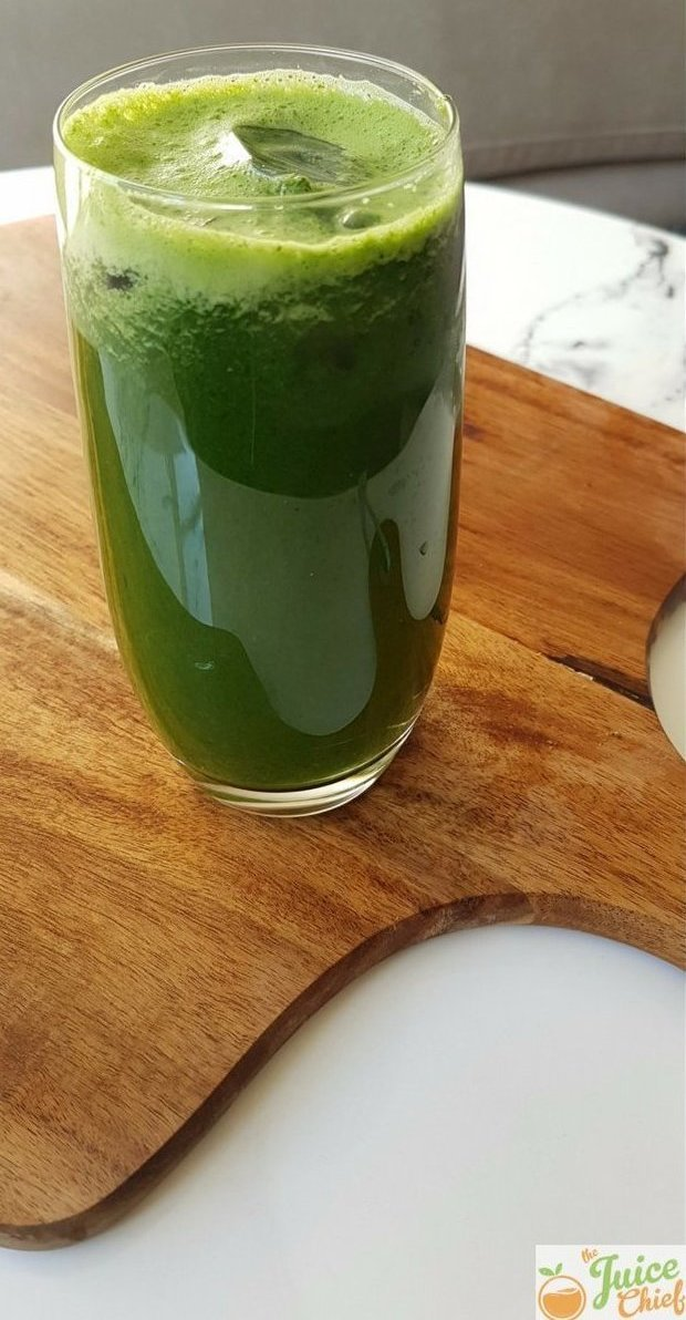 lean green juice in glass on board